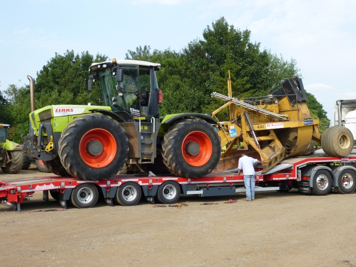 Xerion and Rotary Ditcher leaving for Cheshire
