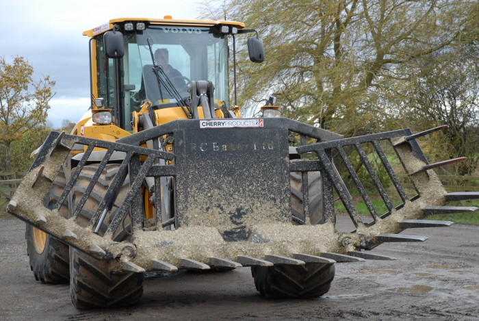 Volvo L70H Loader fitted with a wide, custom made fork by Cherry Products